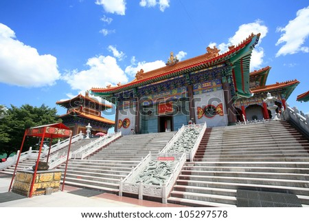 Entrance of chinese temple, wat Leng-Noei-Yi against blue sky in Nonthaburi province, Thailand