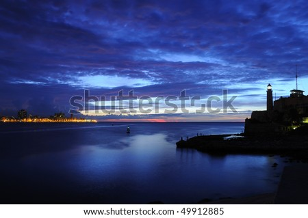 "Entrance of Havana bay with ""el morro"" lighthouse silhouette at dusk"