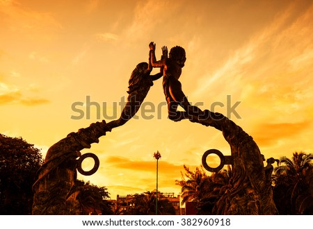 Shutterstock Entrance of the beach in Playa del Carmen at sunset, Mexico
