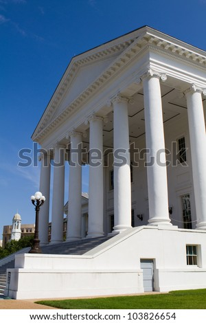 Entrance of the Virginia State Capitol in Richmond, Virginia, USA against a blue sky.