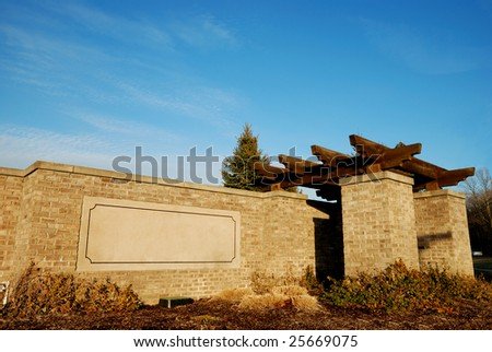 entrance of town with blank board for your own message - stock photo