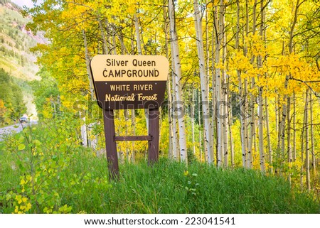 entrance sign to Silver Queen campground in Colorado amidst colorful aspens of autumn