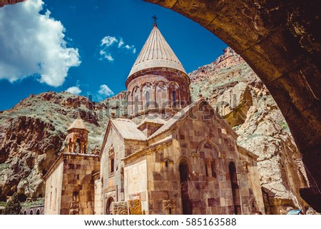 Entrance through tunnel to cave monastery Geghard, Armenia. Armenian architecture. Pilgrimage place. Religion background. Travel concept. Church Astvatsatsin. Tourism industry