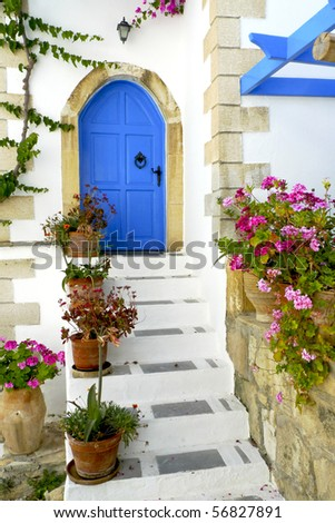 Entrance to a Greek house with a traditional blue door on Crete, Greece