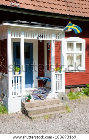 Entrance to a red wooden house in Sweden. summer atmosphere, typical scene