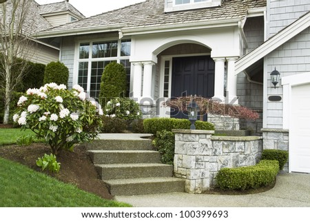 Entrance to house during springtime with blooming flowers