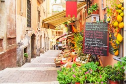 Entrance to local shop in Taormina, Sicily. Writing on the black table lists itmes on promotion.