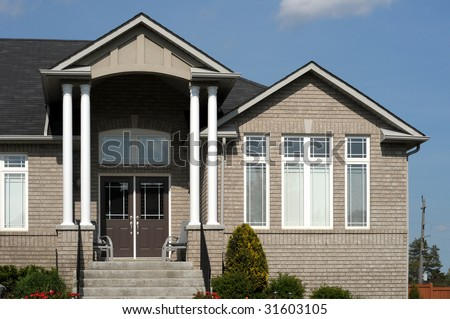 Entrance to luxury house with soaring columns