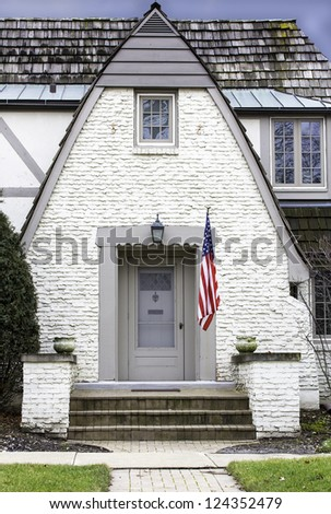 Entrance to old house with american flag