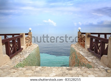 Entrance to Paradise: Steps leading into the Caribbean Sea, merging with the sky, at dusk.
