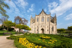entrance to Saint Barbora catherdral with flower garden in Kutna Hora, UNESCO, Czech republic