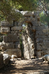 Entrance to the ancient building in the destroyed antique city of Faselis in the south of Turkey