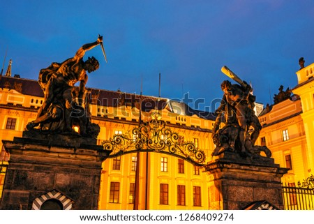 Entrance to the castle with statues, Prague, Czech republic. Night scene. Travel destination. Symbolic object. #1268409274