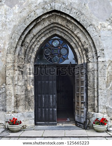 Entrance to the church of Saint John in Cesis, Latvia, Europe