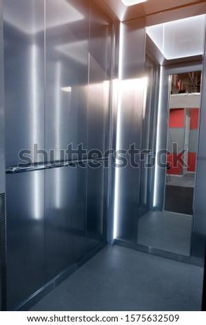 Entrance to the elevator. Metallic elevator doors in silver. Entrance to the elevator