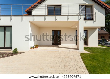 Entrance to the modern house during sunny day