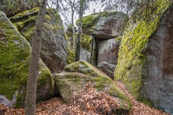 Entrance to the stone church in Thurmansbang - Old church built in a stone cave between erratic rocks and large stones in the Bavarian Forest, Germany