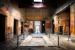 Entrance vestibule inside the of the House of Menander, Pompeii, Italy. The impluvium in the middle of the floor was designed to carry away rainwter coming through the roof.