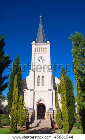 Entrance view of the big white Dutch reformed church (N.G. kerk) in Calvinia, Northern Cape, South Africa, in front of blue sky background