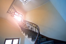 Entrance with stairs in an apartment building in a European house. Hall with a staircase.
