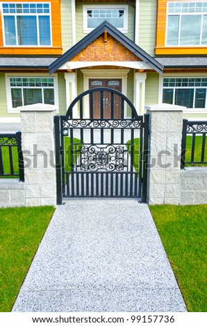 Entrance with the metal gate to the big standard home of the North America.