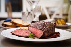 Entrecote with grilled garlic served on a plate