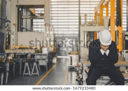 Entrepreneur feel Stressful depressed situation in factory.Unemployed Jobless People Crisis who Recession.Senior worker despair low economic crisis,business failure or government failed manage economy ストックフォト ©