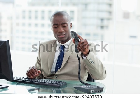 Entrepreneur hanging up in his office - stock photo