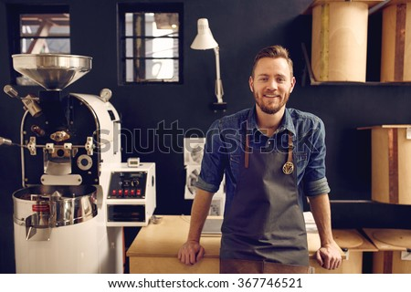 Entrepreneur in his modern coffee roastrery and distribution spa