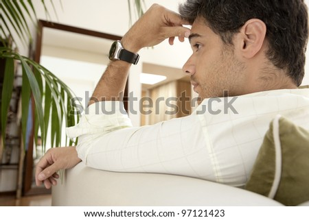 Entrepreneur patiently waiting while sitting on a sofa.