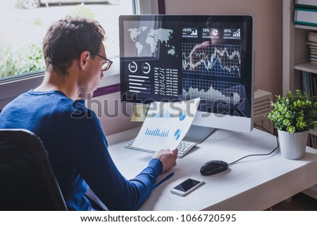 entrepreneur reading financial report on dashboard, fintech and audit concept, monitoring revenue statement of performance of the company