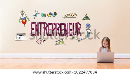 Entrepreneur text with little girl using a laptop computer on floor