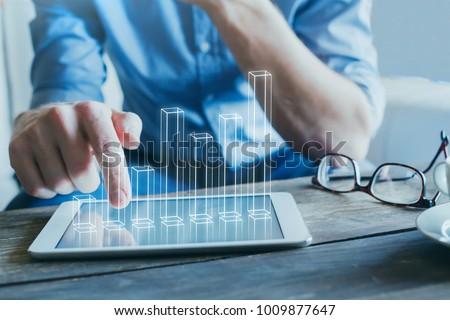 entrepreneur using digital technology for business start-up, 3d column chart