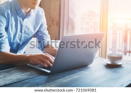 entrepreneur working on laptop online, man using computer at home #721069081