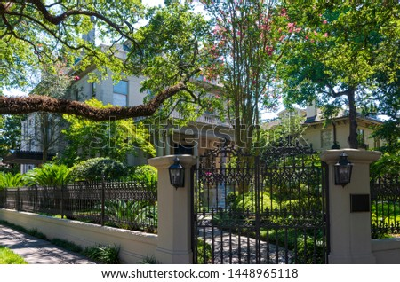 entry gate and landscaped yard to home in historic garden district of new orleans louisiana