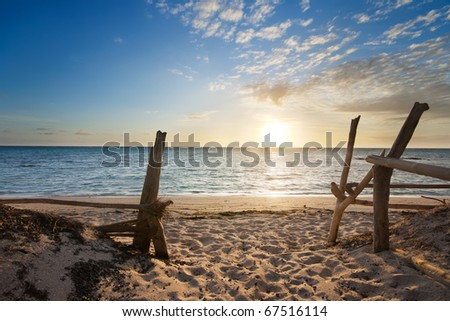 Entry to isolated beach at sunrise with interesting clouds formation