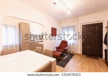 Entry with table, chairs and armchair. Nobody inside