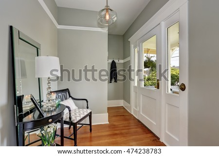 entryway with gray walls ...