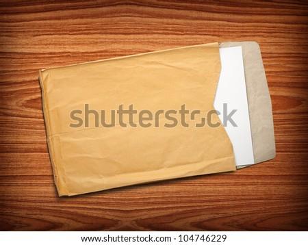 Envelope documents on vintage wood