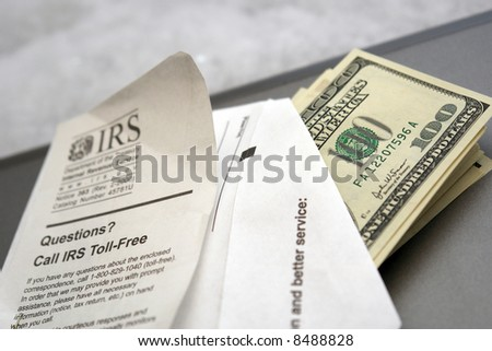 envelope full of money, coming from or going to the IRS