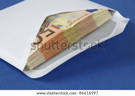 Envelope full with money on blue background