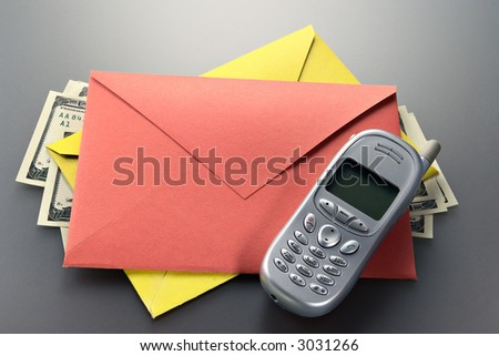 Envelope, mobile phone, dollars-conditions of the modern businessman