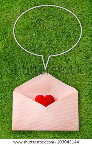 Envelope with red heart and speech bubbles on green background