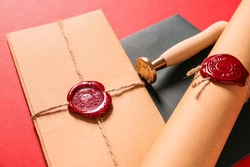 Envelopes and scroll with wax seal stamp of notary public on color background