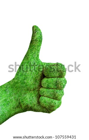 Environment concept - human hand with thumb up covered in grass isolated on white background