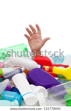 Environment concept with plastic waste covering man hand - isolated