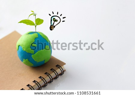 Environment conservation idea concept , earth and light bulb with plant #1108531661