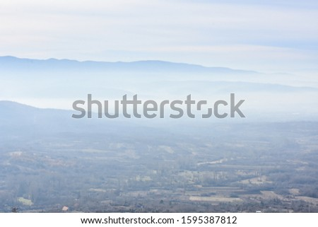 Environment pollution, foggy landscape of valley. Fog and pollution above the city of Nis, You can't see the city from smog Foto stock ©