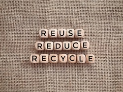 Environmental awareness and educational concept. REUSE, REDUCE and RECYCLE written on wooden blocks.