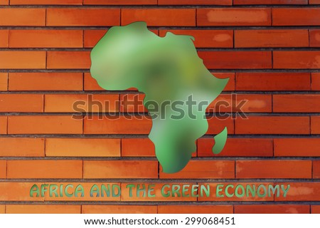 environmental awareness and green economy: illustration with map of africa made of green leaves blur
